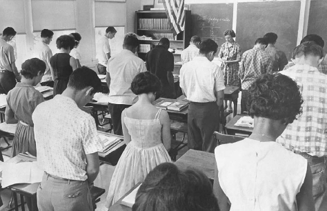 Students at a San Antonio high school pray, two days after the Engel v. Vitale ruling that held that the recitation of an official prayer in public schools violated the First Amendment. © BETTMANN/CORBIS. REPRODUCED BY PERMISSION.