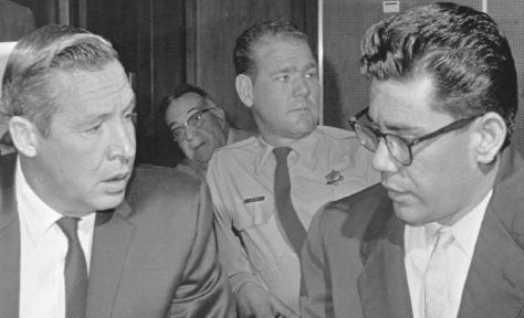 Ernesto Miranda (right) leaves a Phoenix court with his attorney. Miranda confessed to raping a girl after police misled him to believe they had sufficient evidence against him. Though the Supreme Court held that his confession was inadmissable, Miranda w