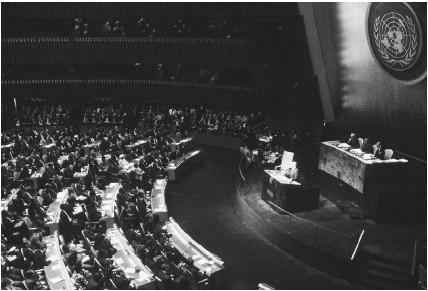 Soviet leader Mikhail Gorbachev addresses the United Nations in December 1988. He announced cuts in the Soviet military budget as well as a withdrawal of fifty thousand troops from Eastern Europe. Photograph by Robert Maass. Reproduced by permission of th