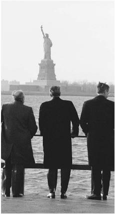 Soviet leader Mikhail Gorbachev (left), U.S. president Ronald Reagan, and Vice President George Bush look at the Statue of Liberty in December 1988. Reproduced by permission of the Corbis Corporation.