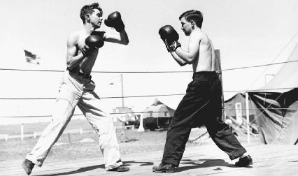 Two young men in a boxing match