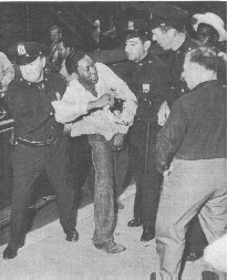 Police arresting a man during the 1943 Harlem riots.