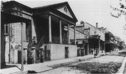 A street scene in the French Quarter of New Orleans, Louisiana, the setting of Kate Chopin