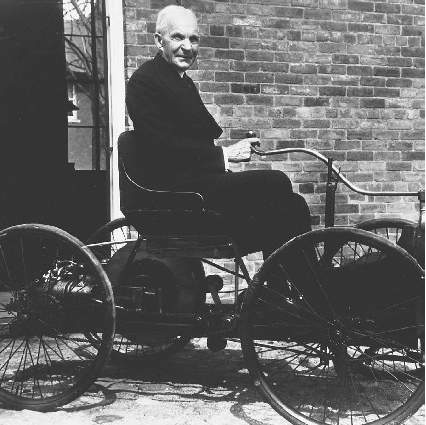 At eighty-three years old, Henry Ford poses for a photo in his first automobile. Henry Ford popularized the efficient assembly-line method of production when, in 1913, he used it to produce the Model T.