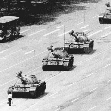 In the late 1940s, Orwell used many aspects of existing totalitarian and communist governments to construct the fictional government of Nineteen Eighty-Four. Pictured here are Chinese army tanks bearing down on a man during the Tiananmen Square uprising o