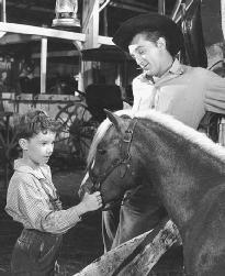 Peter Miles as Thomas Tiflin and Robert Mitchum as Bill Buck in the 1948 film adaptation of The Red Pony