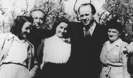 Oskar Schindler in 1946 pictured with a group of Jews that he employed and rescued