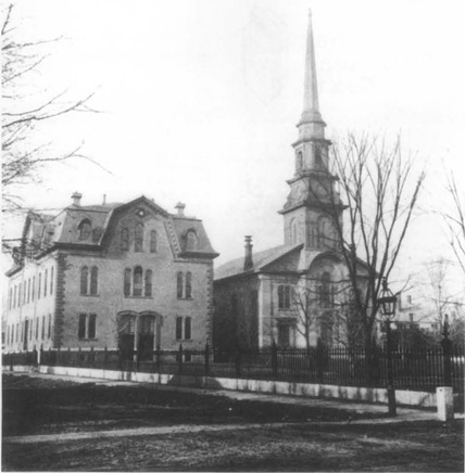 Old church with steeple, c. 1900, a symbol of the religious character of the people scrutinized in The Man That Corrupted Hadleyburg.