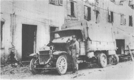 Ambulance and driver on a city street in Italy during World War I.