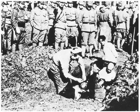 Chinese prisoners being buried alive by their Japanese captors outside the city of Nanking, during the infamous Rape of Nanking. [BETTMANN/CORBIS]