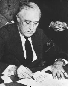 President Franklin D. Roosevelt signing the declaration of war against Japan, Dec. 8, 1941. (Reproduced by permission of the National Archives and Records Administration)